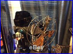 Antique snowflake Menominee Brass cage fan super rare and works good